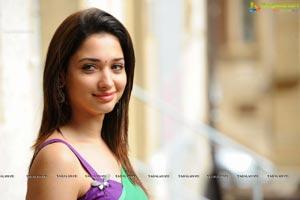 Hot Tamanna in Sleeveless Blouse and Transparent Green Saree